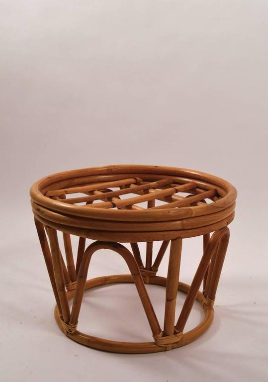 Nice circular bamboo footrest, ottoman. Comes with upholstered pad top, in black fabric. Measures: Diameter at top 19