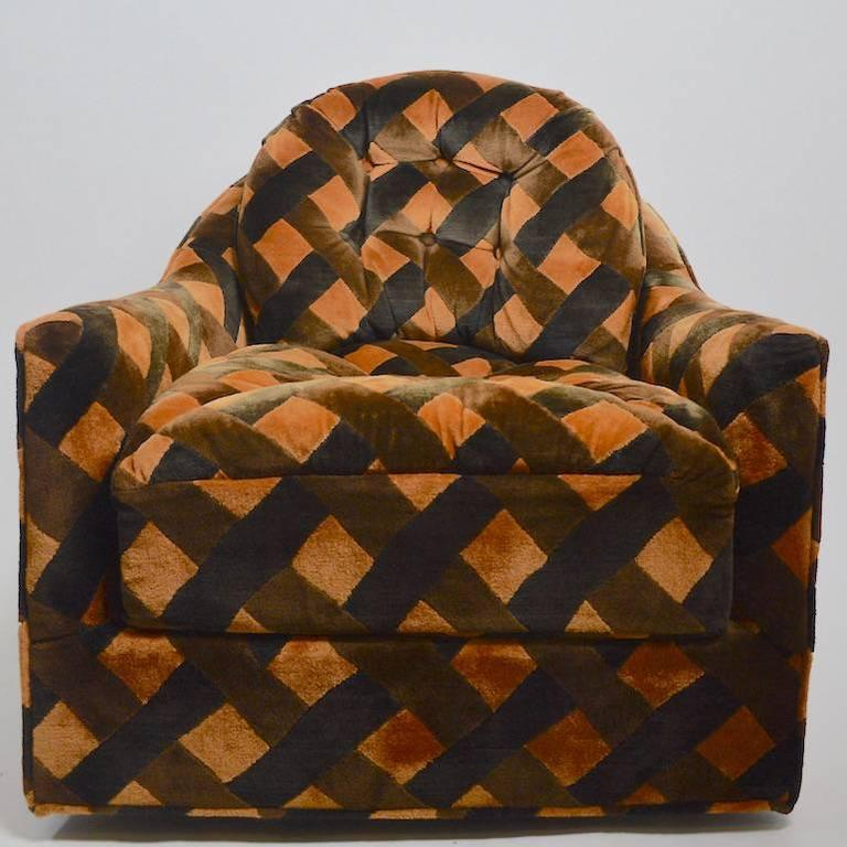 Pair of swivel club chairs by the Royal Lounge Company, in the style of Milo Baughman. Both are clean, and ready to use, the fabric has some fading on the backs of the chairs, as shown. Deep, soft and comfortable, stylish pair of chairs.