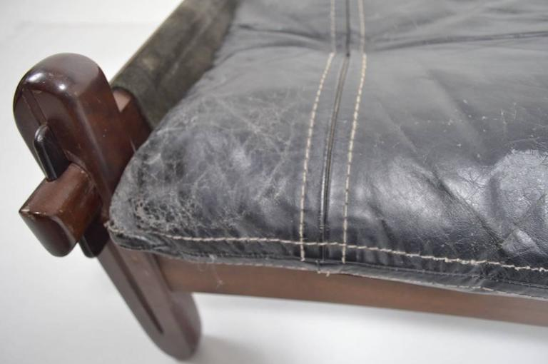 Hard to find item by Brazilian designer Jean Gillon. This example is in fair condition, showing cosmetic wear and one tenon has been cracked and re-glued.