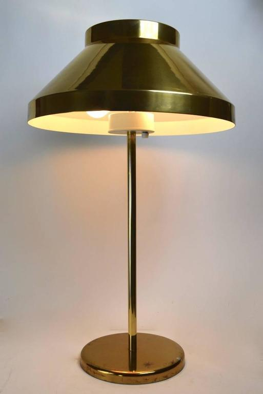 Unusual large brass lamp, designed by Paul Mayen for Habitat. This example is in very good, original; working condition.it features two porcelain sockets, and an adjustable harp. The base shows some minor cosmetic wear to finish, as shown.