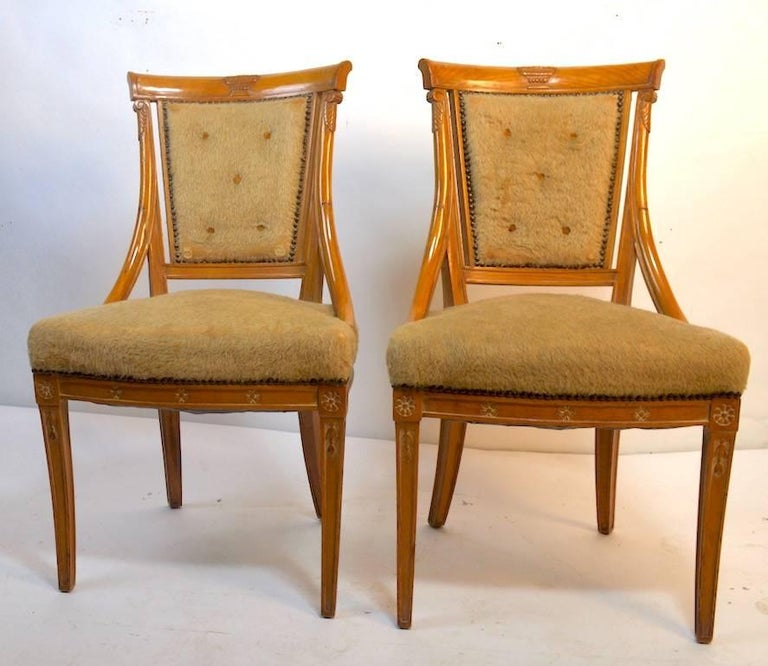 Elegant set of dining chairs by Grosfeld House in the Hollywood Regency, Neoclassical style. Currently in original upholstery, which shows wear. Hand-carved wood frames and tied spring seats exhibit the top quality workmanship expected from Grosfeld