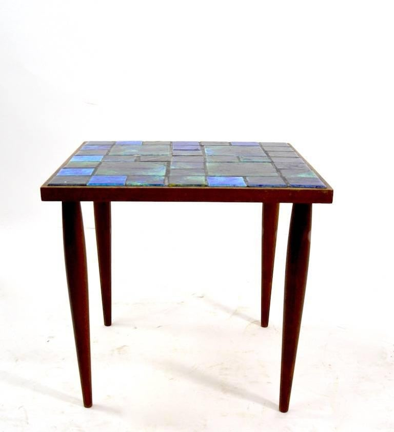 Matched pair of mosaic top tables by Georges Briard. Overall very fine condition, one tile shows minor loss, as shown. Selling and priced as a pair.