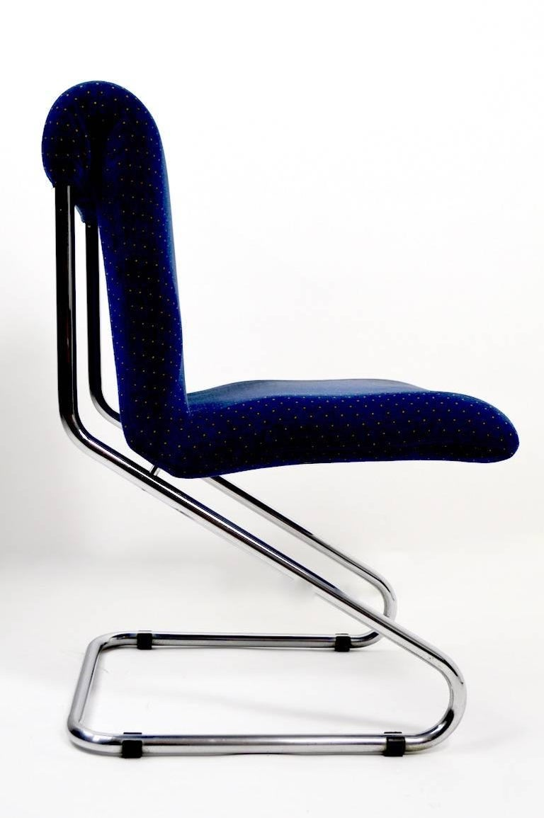 Cantilevered tubular chrome dining height chairs ( seat H 19.5 ). The chairs are in good original condition, fabric shows some cosmetic wear, normal and consistent with age.