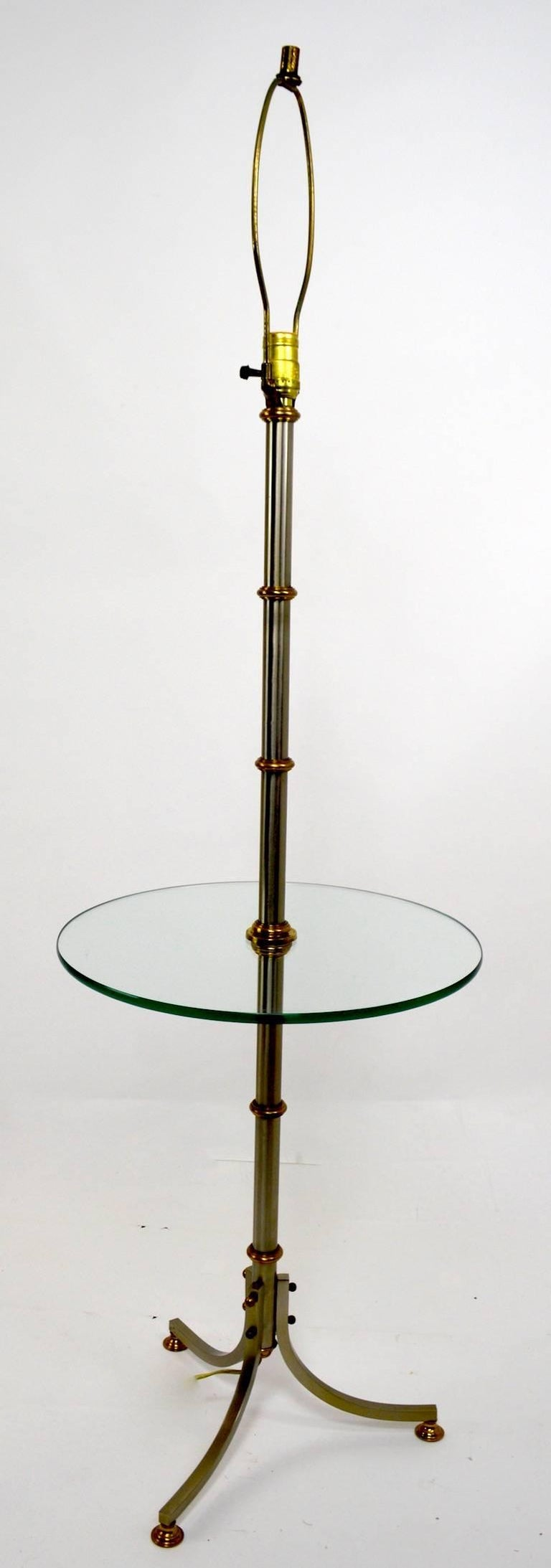 Floor lamp with glass shelf after Maison Jansen. Measures: Shelf height 21.5 inches, shelf diameter 16 inches.