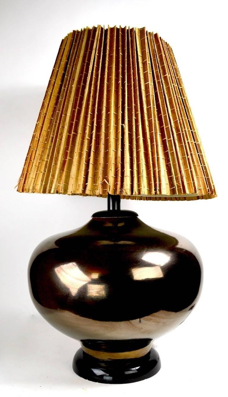Impressive metallic glaze ceramic table lamp, mid century production, with obvious Chinese influence. Original, clean, working condition, shade not included. Well made, and very heavy, this lamp will make a statement en situ. Height to top of