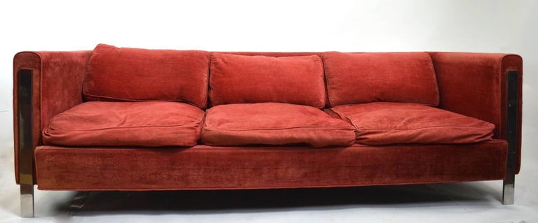 Even arm box sofa in original velvet blend upholstery (fabric shows wear), down cushions and bright chrome legs. Classic 1970s form attributed to Milo Baughman. Usable as is if you like the broken in look, or reupholster to your requirements if you