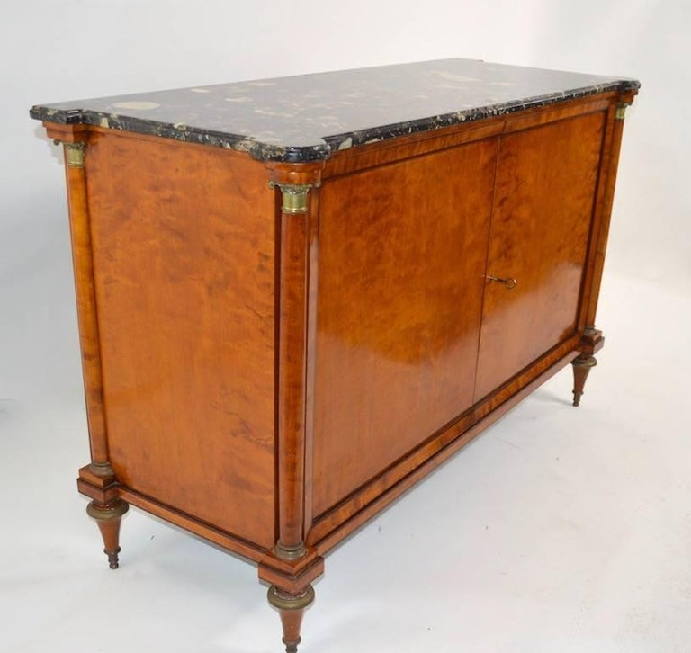 Stylish Directoire style cabinet in satinwood, with marble top. Two doors open to reveal shelved storage. The doors do not close to flush, but will stay closed when cabinet is locked, as shown. Marble top .75 thick.