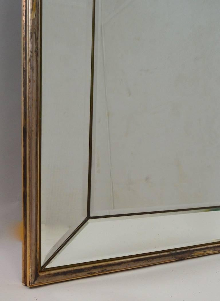 Wonderful tall arched mirror with segmented bevelled mirror surround trim, and silver gilt frame. Gilt shows minor wear and loss, normal and consistent with age. We can offer frame restoration if you prefer a more mint condition look. Each side