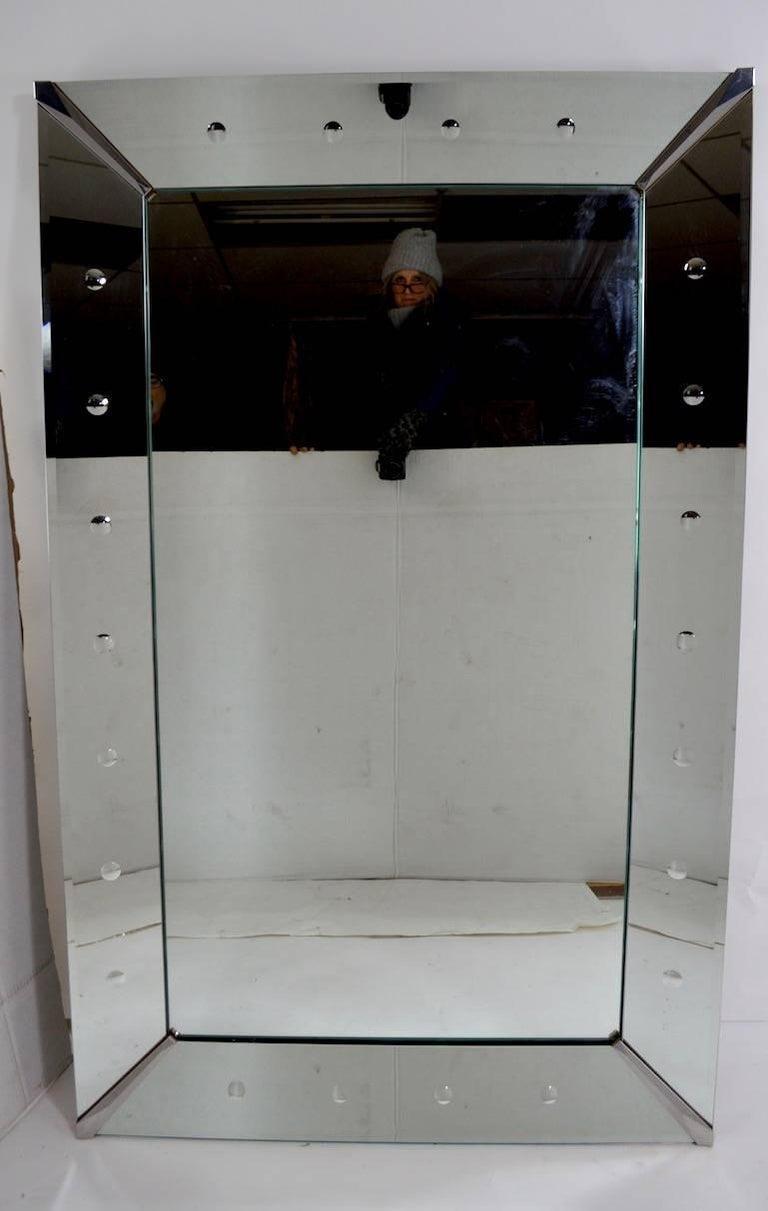Art Deco plate glass mirror framed by dot motif mirrored trim. Original, clean ready to use condition, currently configured to hang horizontally, but can easily be reconfigured to hang vertically. Each side mirror approximately 5 7/8 inch wide.