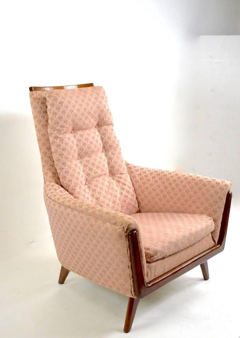 High back lounge chair by Adrian Pearsall for Craft Associates. This example is in very good condition, however has been reupholstered in later pink scalloped fabric. Measures: seat 16 x arm H 22.