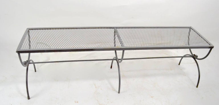 Modernist, neoclassical style bench attributed to Woodard. Nice example suitable for indoor and or outdoor use, currently in later grey paint finish, which shows wear. Usable as is, or we offer custom powder coating if you want a more finished look.