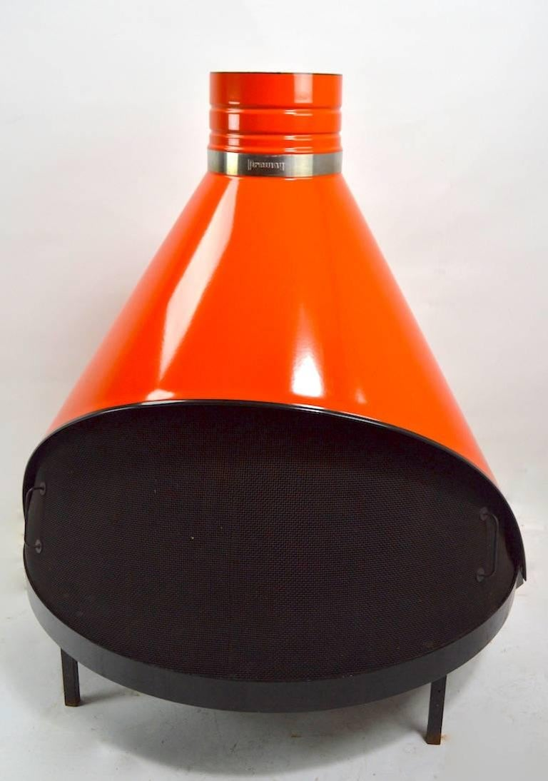 Orange enamel Preway cone form fireplace in extra fine original condition. This example comes with two exhaust tubes, (each tube 32 inch) a curved elbow joint, and the original wall washer ring. Unusual to find these in such fine condition, clean,