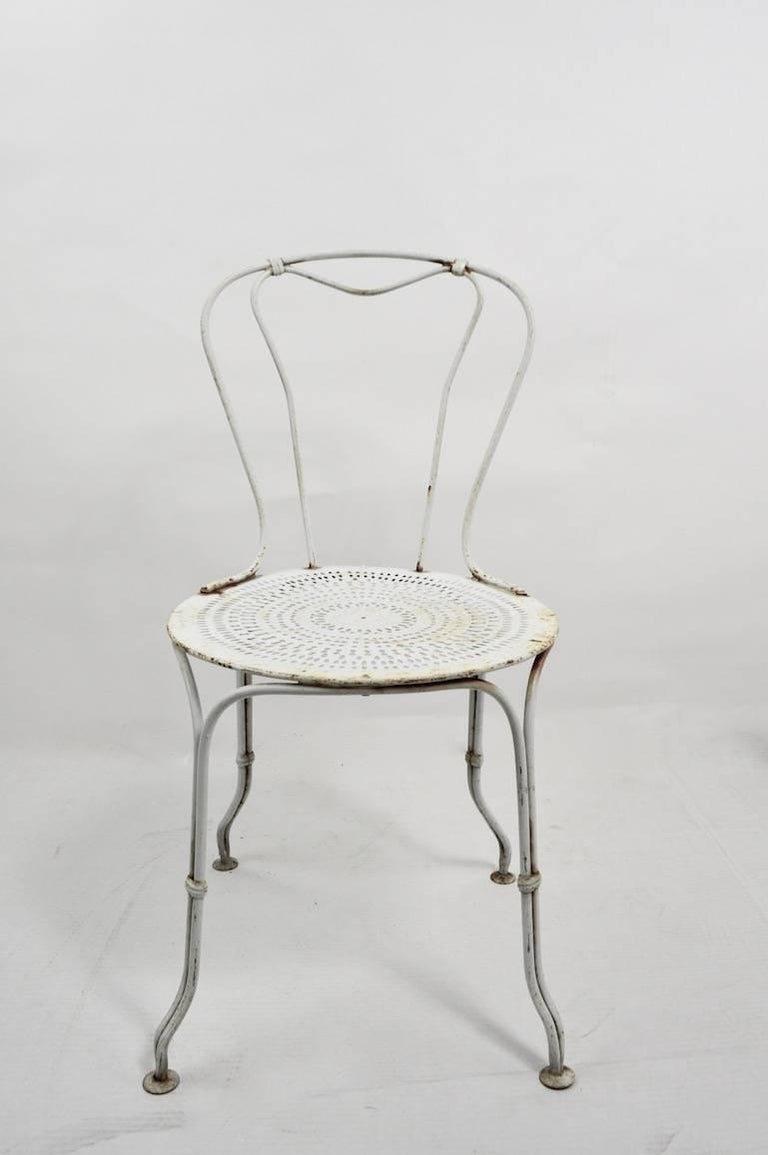Four matching iron and steel cafe style dining chairs, suitable for indoor or outdoor use. All are in very good, original condition showing only light cosmetic wear normal and consistent with age. Measure: Seat H 16 inch. We believe these are