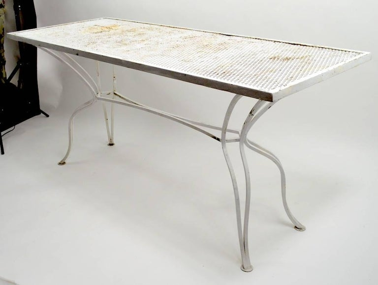 Metal mesh top on sinuous wrought iron legs, unusual form not often seen, console or serving table attributed to Salterini. Currently in white paint finish, which shows wear, usable as is or we offer custom powder coating if you want a more polished
