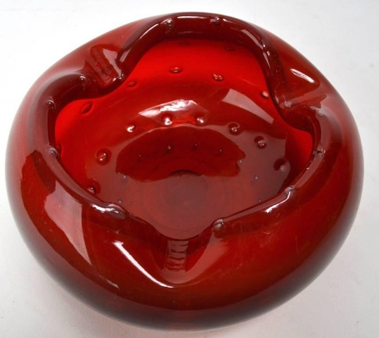 Nice deep and vibrant red Murano glass ashtray. Two of the controlled bubbles have Popped, that is are open, this is the way the item was produced, not damage, item free of chips, scratches etc.