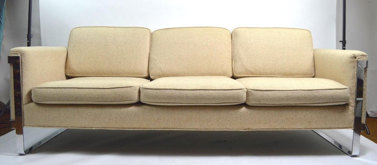 Sexy and sophisticated sofa, design attributed to Milo Baughman. Large scale, well crafted with top quality materials, and fine craftsmanship. Solid, and sturdy, upholstery shows some wear, and discoloration. Please view the companion barrel lounge
