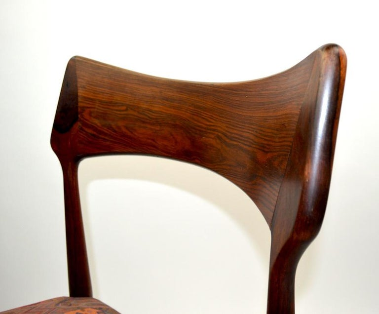 Slick and sophisticated set of rosewood dining chairs, made in Denmark, attributed to AM Mobler. Clean, original condition, ready to use. Measures: Seat Height 17 inches.