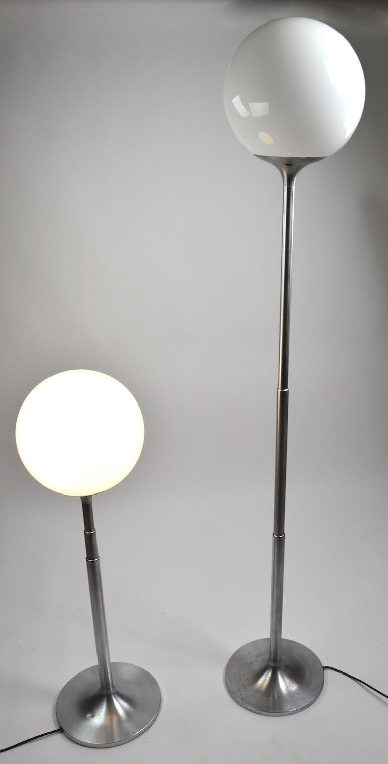 International Style Pair of Adjustable Steel and Glass Floor Lamps Attributed to Kurt Versen For Sale