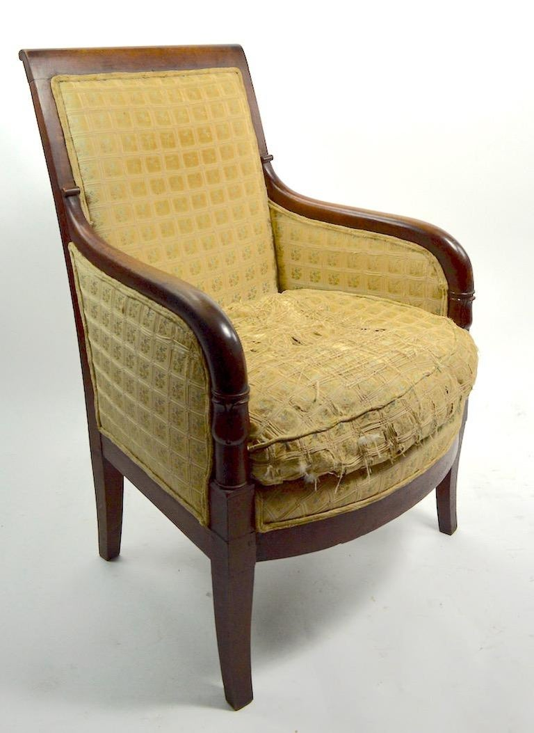 Solid walnut frame, pegged construction, carved wood frame, upholstered seat and back - upholstery worn and will need to be replaced. Rear leg shows minor loss at base, as pictured. We believe this example is American in the French style.