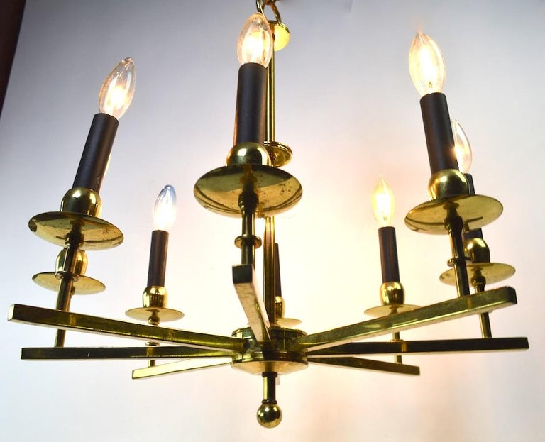 Stylish brass spoke style hanging fixture, in original and working condition. The chandelier shows some cosmetic wear to the finish, normal and consistent with age. Measures: Height (22 inches), does not include the chain or canopy.