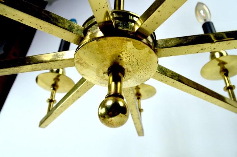 Hollywood Regency Eight-Light Brass Spoke Chandelier For Sale