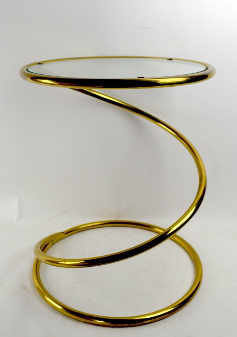 Unusual brass version of the classic coil spring glass top table attributed to Pace. Nice original condition, clean, ready to use.