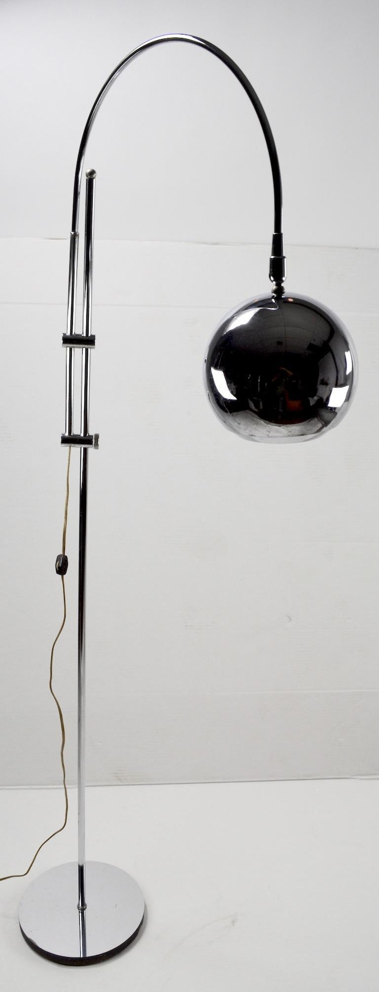 Nice quality adjustable chrome floor lamp. This floor lamp can be raised, lowered, the arc arm swivels, and the ball shade pivots , allowing for infinite adjustments to position the light exactly where you want it. Lamp accepts a standard screw in
