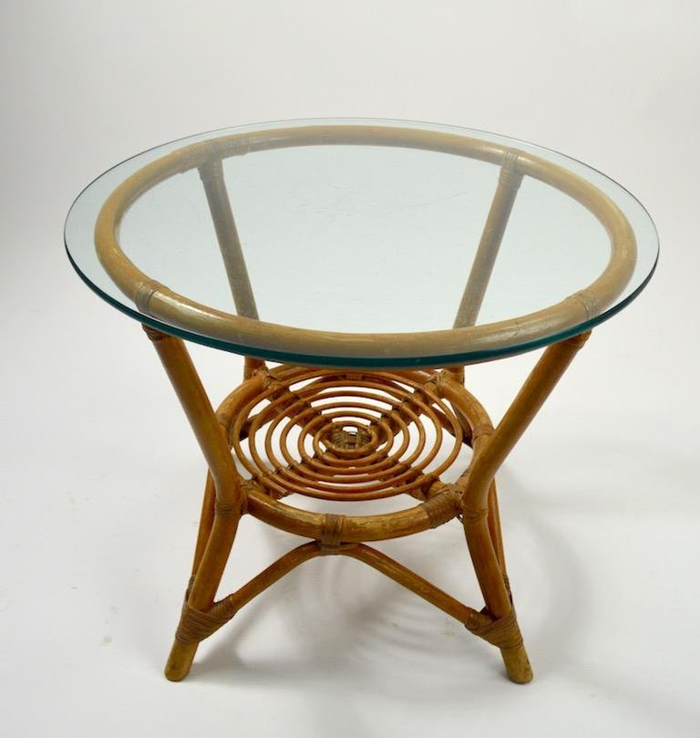 Small bamboo table with original plate glass top, top shows significant scratches. Nice diminutive size, usable as an end or side table.