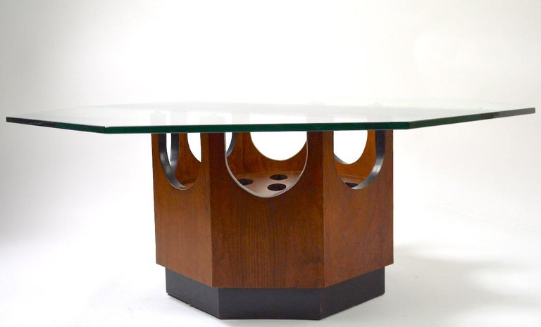 Octagonal wood base with oval cut out decorations, supports the thick ( 3/8 inch ) octagonal glass top. Each side measures 38 inches. Stylish midcentury table attributed to Harvey Probber, in very good original condition, glass top has a couple of