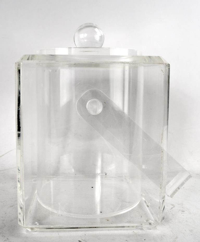 Glamorous Lucite ice bucket with swing handle and ball knob top. Clean, original condition, ready to use.