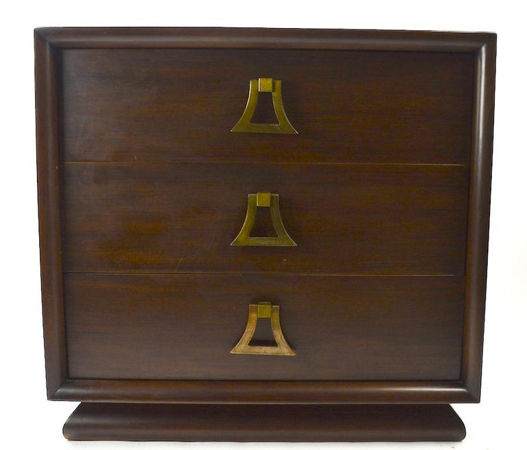 Tailored style three drawer Bachelors chest in Mahogany (veneer) with large stylized drop pulls. Three nice deep drawers ( 7 inch each ) provide ample storage space. Very good original condition, showing only light cosmetic wear, normal and