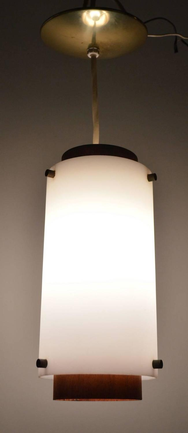 pair of hanging cylinder tube light fixtures at 1stdibs