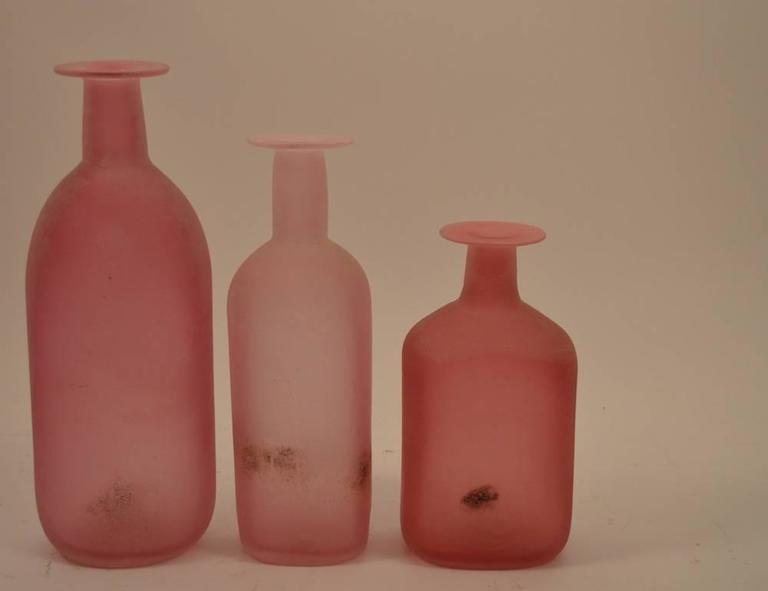 Three vintage Cenedese vases, done in the Scavo finish. Each is a different shade of pink, all have labels, and are in perfect condition. Dimensions in listing are for the tallest, middle size: 13.5