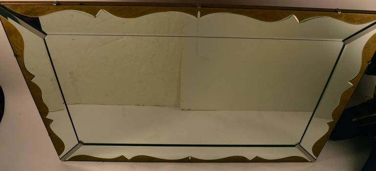 Unusual Art Deco mirror, with mirrored frame, and gold decorative trim. Currently configured to hang horizontally, however easily reconfigured to hang vertically. Dramatic and stylish large plate glass mirror. Mirror frame 6