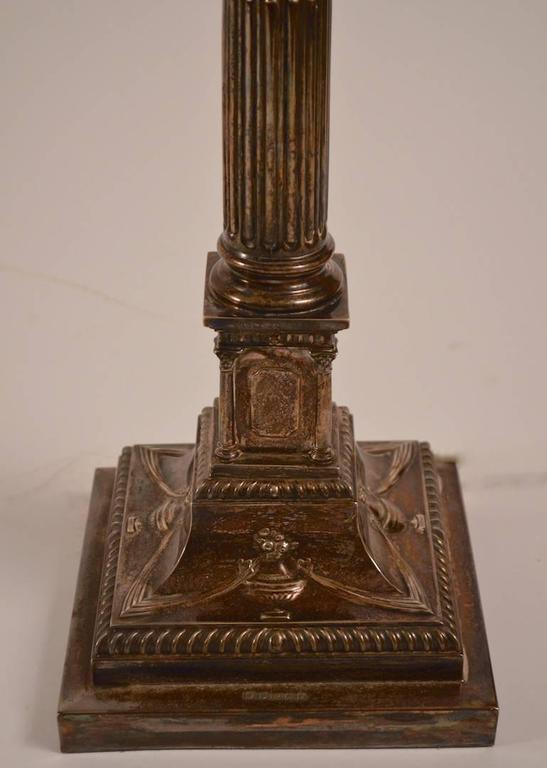 Pair of classical silver plate column lamps, with urn and swag decoration on the base. Working, original condition, shades and finials not included. Height to top of column 22