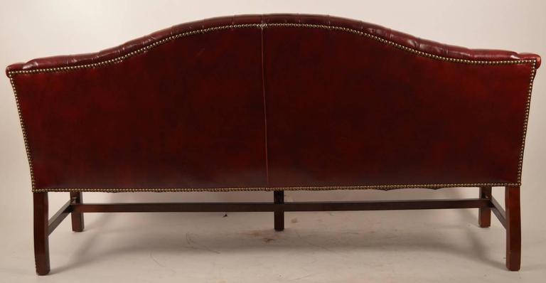 Burgundy Leather Chippendale Camelback Sofa