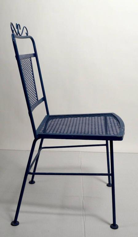 Four matching patio, garden dining chairs by Woodard. All chairs are in very good condition, showing only normal cosmetic wear. Iron and mesh construction, suitable for indoor or outdoor use.