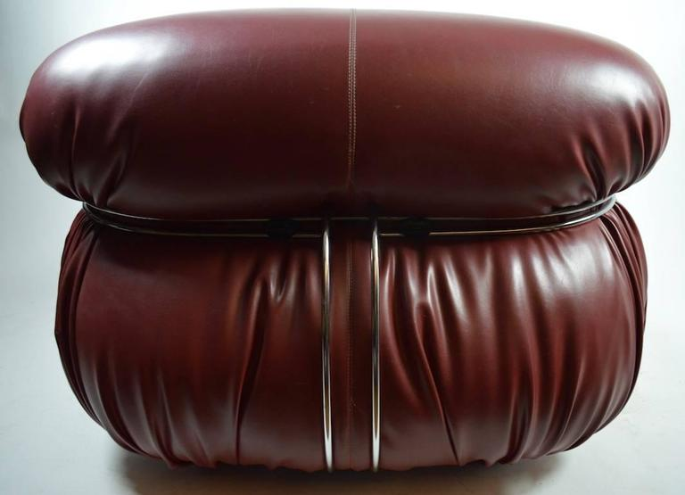 Designed by Afra and Tobia Scarpa for Cassina, made in Italy. This example is in an unusual Burgundy color leather, it is in great, original condition, and retains the original labels on the bottom.