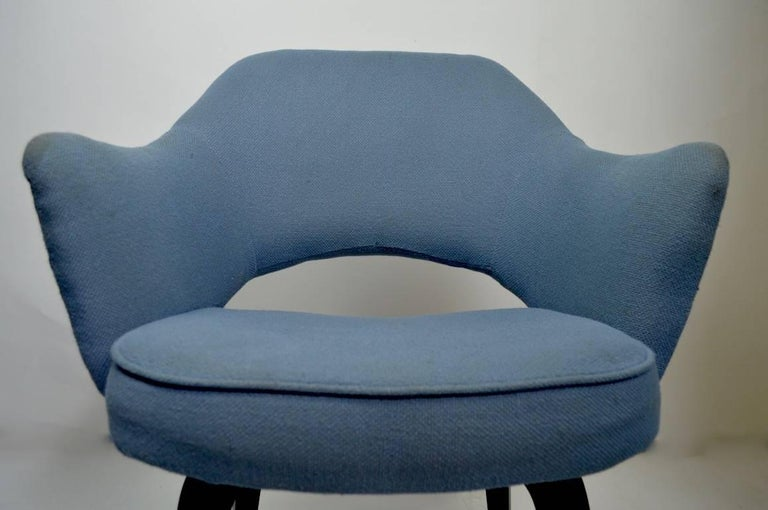This is an early version of the classic Saarinen design for Knoll dining chair. We have a total of three of these original, wood leg version of this classic Saarinen for Knoll design chair. Measures: Seat height 17.5 inches arm height 25 inches.