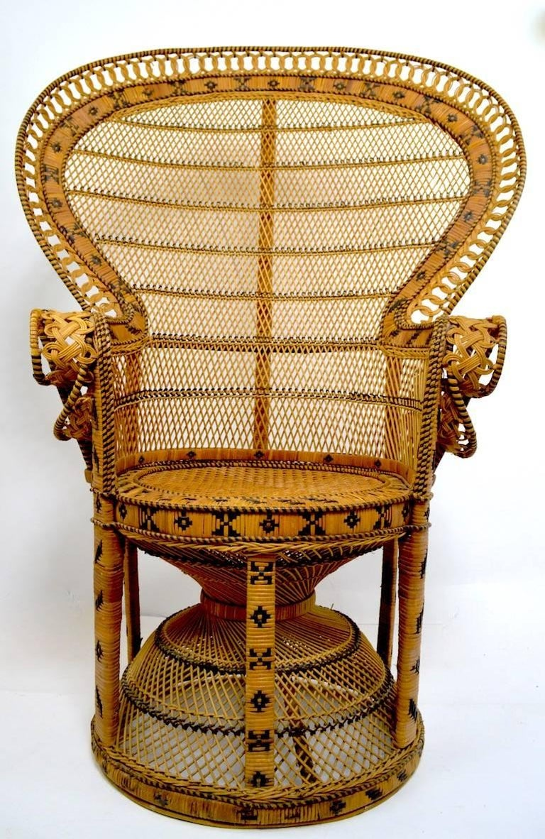Classic Emmanuel peacock wicker, rattan chair. This example shows some minor wear, normal and consistent with age. Measures: Seat height 18, arm height 29. Clean, sturdy and ready to use.
