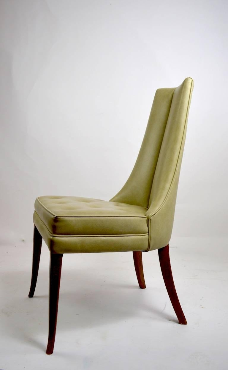 Very chic high back armless side chairs, in original pale green vinyl upholstery. Both are clean and ready to use showing only very light cosmetic wear, normal and consistent with age. Measures: Seat height 18.5 inches.