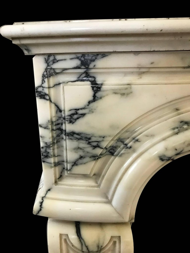 Pompadour style mantel hand-carved Arabescato marble.  Opening dimension: 47 1/4