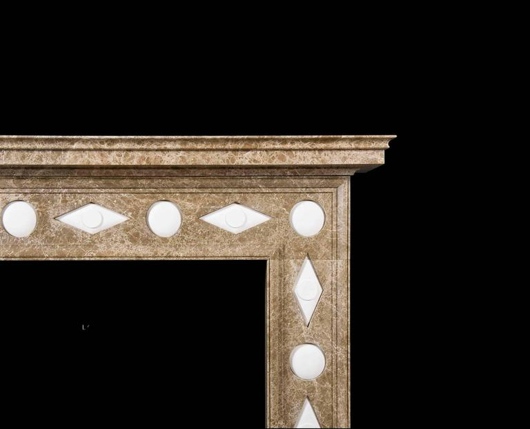 From the Bunny Williams collection. the Veneto re-works a Classic Regency design in a truly original manner with a traditional frame fabricated in light Emperador marble and comprising plain panels ornamented with repeating convex orbs and diamond