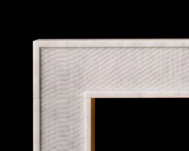 The Python by Alexa Hampton is a modern mantel with beautifully carved detail simulating snake skin. Shown carved in Carrara marble. 