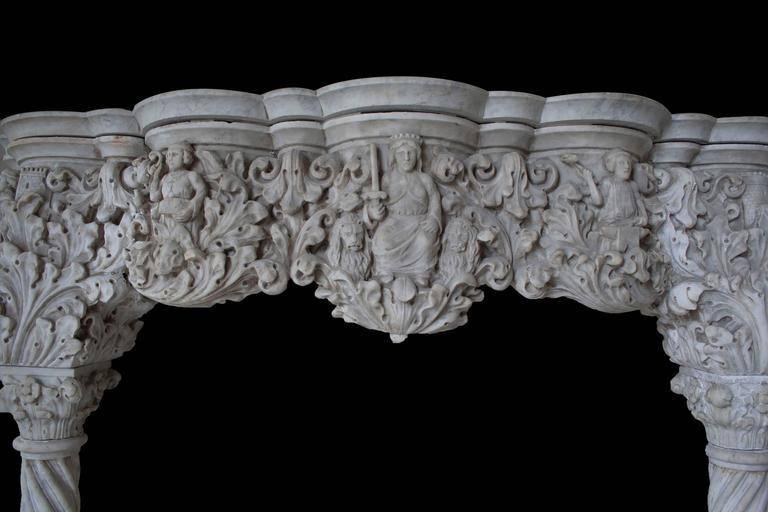 """Ornate venetian carrara mantel in the Gothic style. Showcasing a highly detailed frieze featuring a royal court, castle towers, and acanthus leaves. supported by lions carrying barley-twist columns.  Opening width: 50""""."""