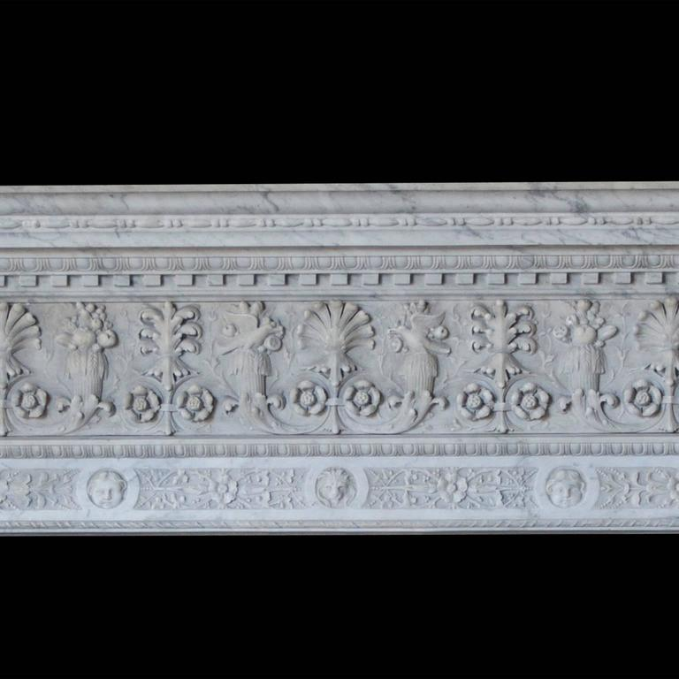 An impressive, late 19th century, Italian Renaissance fireplace in Carrara marble. The frieze carved with continuous anthemion and foliate detail, the jambs fluted decorative baluster pedestals, with scrolled capitals surmounted by acanthus