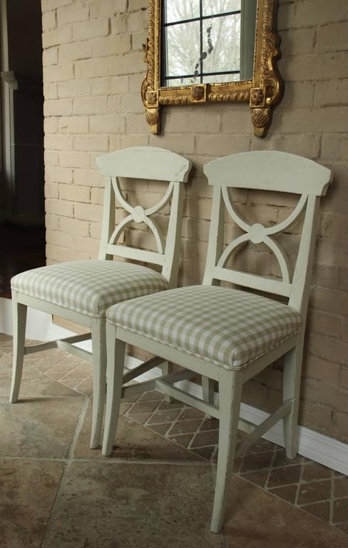 A pair of Swedish Gustavian style side chairs from the mid 19th century, newly upholstered in a beautiful Elizabeth Eakins linen check.