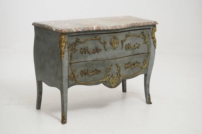 19th century French commode in the Louis XV Rococo style with a shaped front and sides.  This spectacular chest of drawers has original gilded bronze ormolu mounts, gilded bronze hardware and shaped marble top.