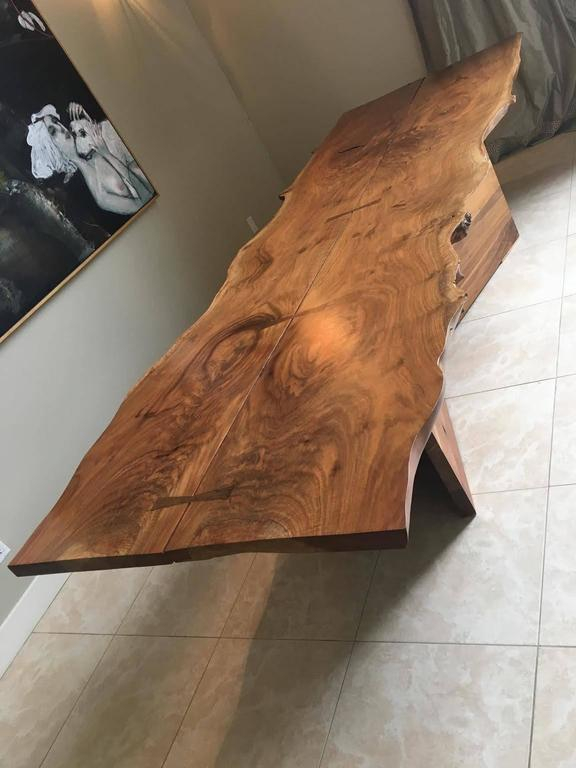 An exceptional dining table by Twentieth Studio made of American black walnut with exquisite butterfly joinery. The top is removable for easy transport.