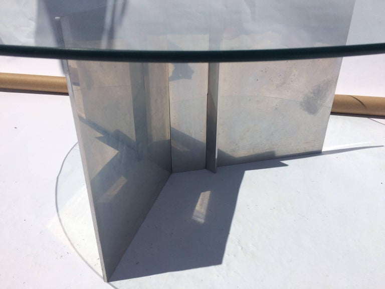 Simple and beatiful aluminum and glass coffee table.